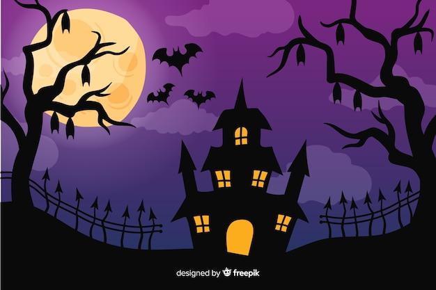 Halloween-achtergrond in handgetekende ontwerp