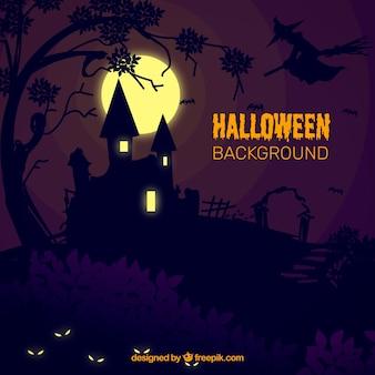 Halloween achtergrond met herenhuis in de nacht