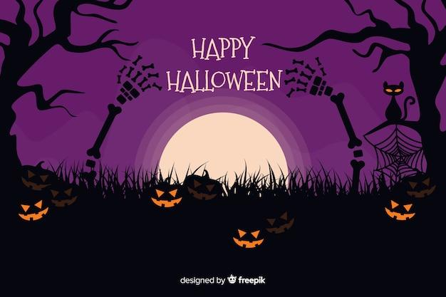 Halloween-achtergrond met pompoenen op een purpere nacht