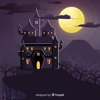 Halloween-achtergrond met spookhuis op een heuvel