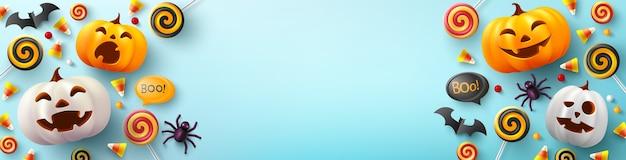 Halloween-banner met leuke halloween-pompoen, vleermuis, spin en suikergoed op lichtblauw
