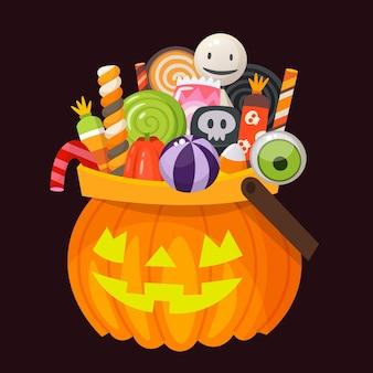 Halloween-emmer in de vorm van een pompoen vol snoep, snoep en desserts