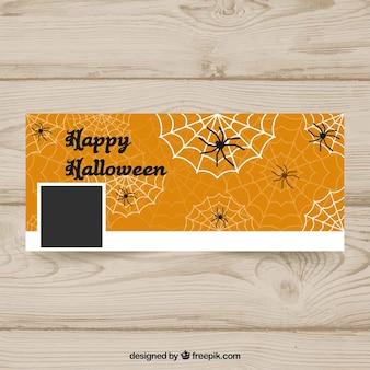 Halloween facebook cover met spinnenwebben