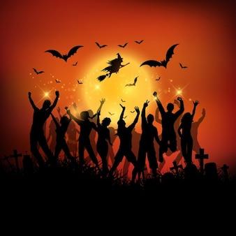 Halloween party landschap met silhouetten van mensen dansen