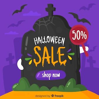 Halloween-verkoop op een grafsteen in nacht