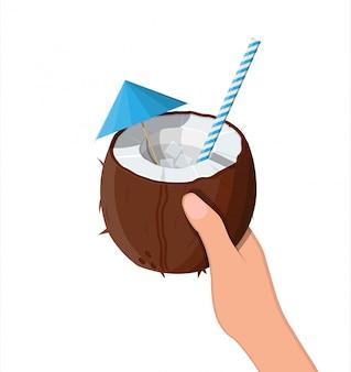 Halve kokos in de hand. koude drank