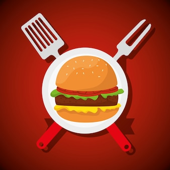 Hamburger met vork en keukengerei