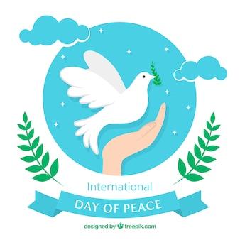 Hand achtergrond met duif van vrede in de lucht