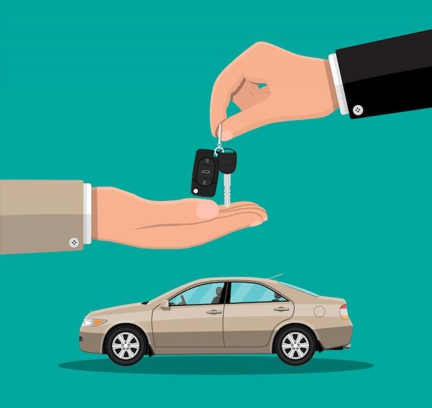 Hand geeft autosleutels aan een andere hand