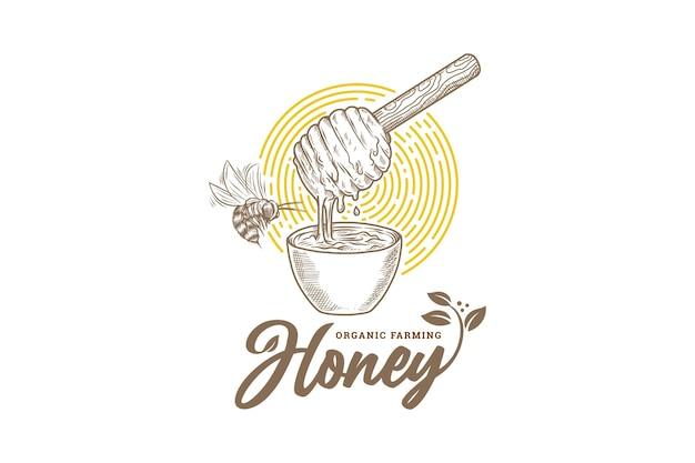 Hand getekend biologische natuurlijke honingbij landbouw logo met bladeren