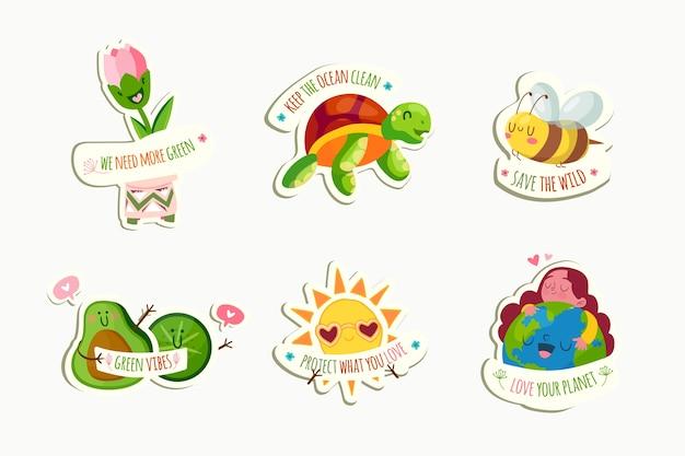 Hand getekend ecologie badges met dieren en aarde
