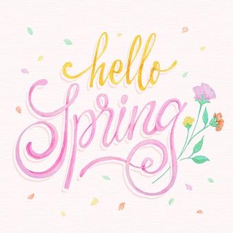 Hand getekend hallo lente belettering met bloemen