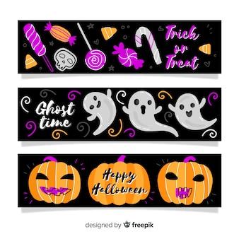 Hand getekend halloween banners met pompoen en geest