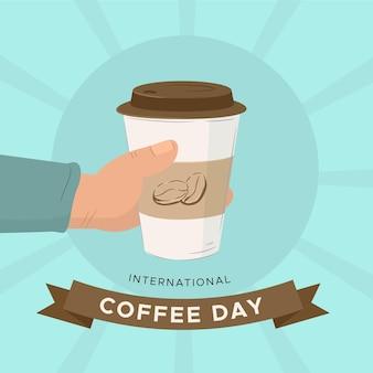 Hand getekend internationale dag van koffie met beker te gaan