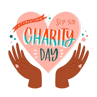 Hand getekend internationale dag van liefdadigheid achtergrond met hart