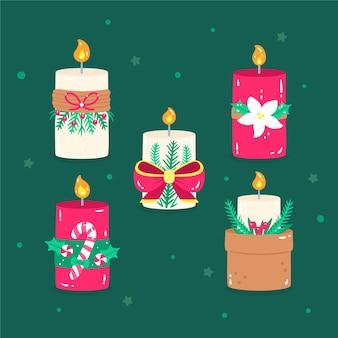 Hand getekend kerst kaars collectie op groene achtergrond Gratis Vector