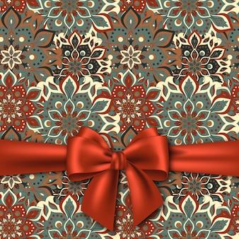 Hand getekend mandala patroon met realistische rode strik. illustratie.