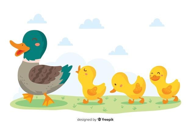 Hand getekend moeder eend en kuikens wandelen