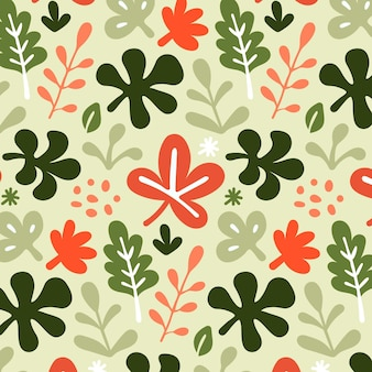 Hand getekend patroon met groene en rode bladeren