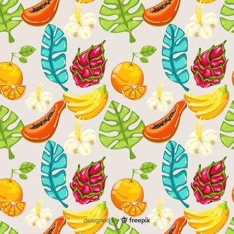 Hand getekend tropisch fruit en bladeren patroon