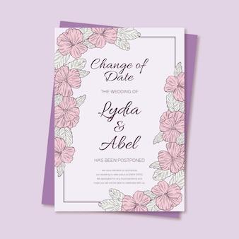 Hand getekend uitgesteld bruiloft kaartsjabloon met bloemen