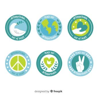 Hand getekend vrede dag badge symbolen collectie