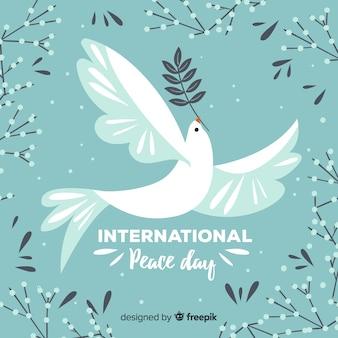 Hand getekend vredesdag achtergrond met duif