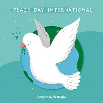 Hand getekend vredesdag duif met wereld