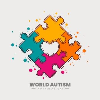Hand getekend wereld autisme dag bewustzijn illustratie met puzzelstukjes Gratis Vector