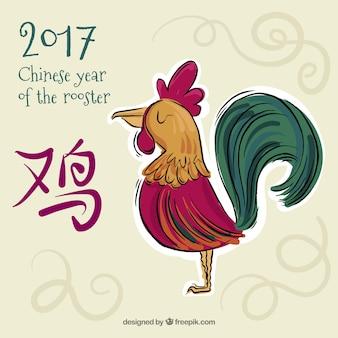 Hand getekende achtergrond voor chinees nieuwjaar met kleurrijke haan