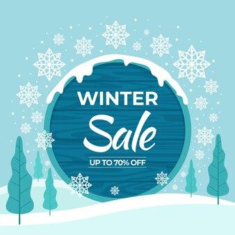 Hand getekende platte winter verkoop illustratie en banner