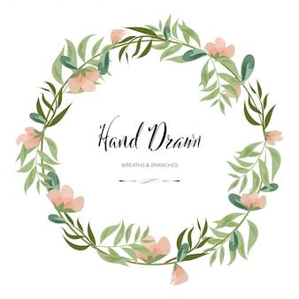 Hand getrokken decoratie geschilderd aquarel krans bloemen ronde frame bladeren en takken.