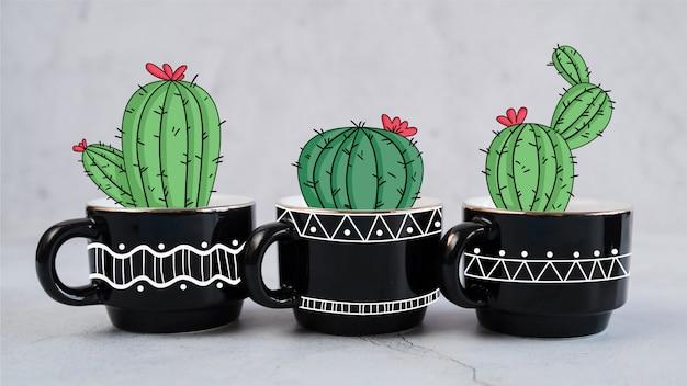 Hand getrokken decoratieve cactus in verschillende mokken