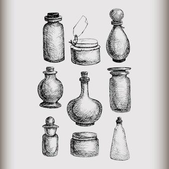 Hand getrokken geïsoleerde uitstekende glaskruiken en geplaatste flessen. containers voor jam, voedsel, attar, otto, etherische olie, oliën, vloeistof, parfum.