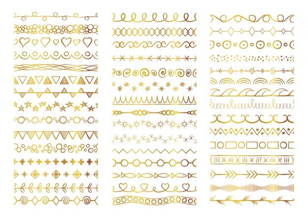 Hand getrokken gouden decoratieve grote borstels instellen.