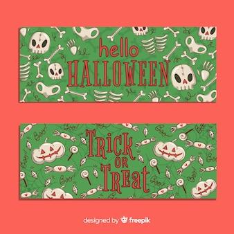 Hand getrokken halloween banners met naadloos patroonontwerp
