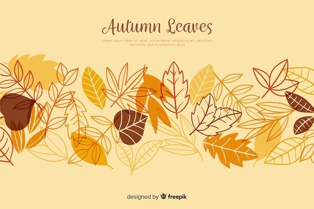 Hand getrokken herfstbladeren achtergrond Premium Vector