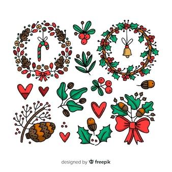 Hand getrokken kerst bloem en krans collectie