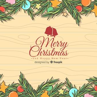 Hand getrokken kerstmis achtergrond Gratis Vector