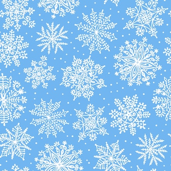 Hand getrokken sneeuwvlokken. naadloze patroon