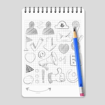 Hand getrokken sociale media netwerkpictogrammen op realistische notebook