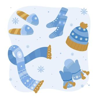 Hand getrokken winterkleren en benodigdheden