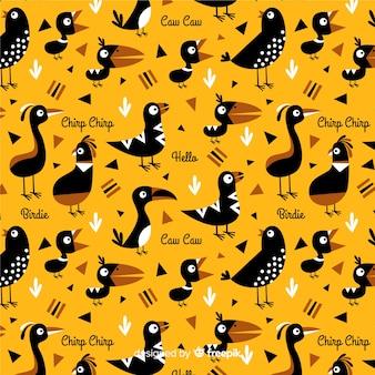 Hand getrokken woorden en vogels patroon