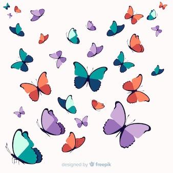 Hand getrokken zwerm vlinder achtergrond