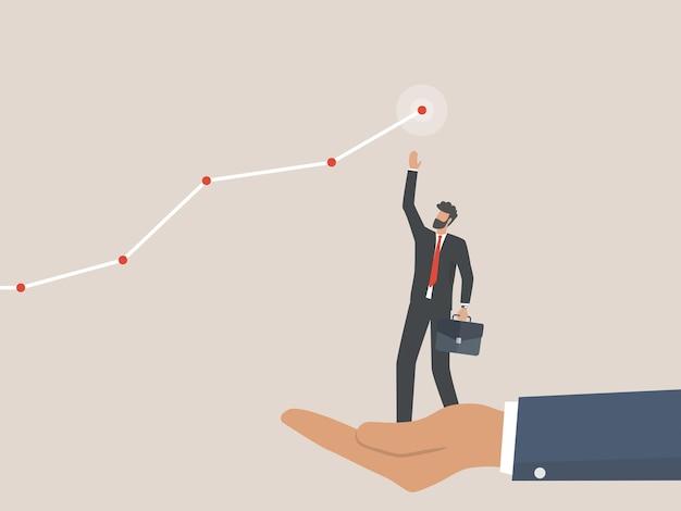 Hand help zakenman om een doel te bereiken