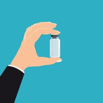 Hand houden apotheek fles glas geneeskunde.