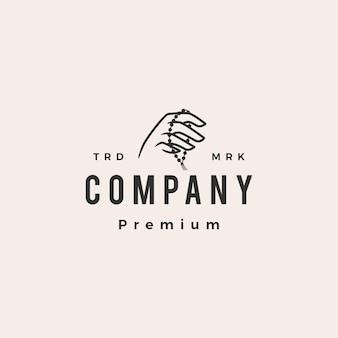 Hand houden biddende kralen hipster vintage logo