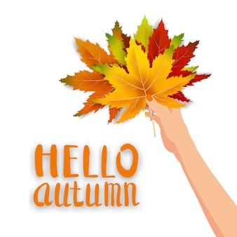 Hand houden herfst kleurrijke bladeren helder boeket herfst, bloemen. hallo herfst belettering