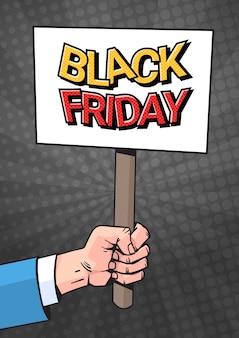 Hand houden plakkaat banner met black friday verkoop tekst