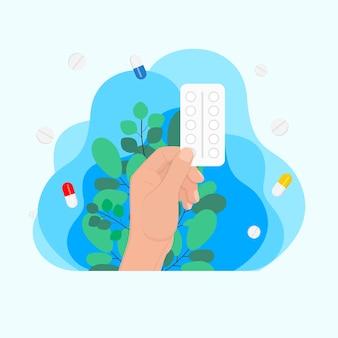 Hand houdt blisterverpakking met pillencapsules, medicijnconcept, ziektebehandelingsconcept. injectie spuit. geneeskunde gezondheidszorg concept. medische achtergrond